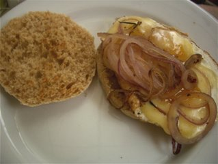 Fried Egg, Fried Onion, and Womanchego on Homemade English Muffin.